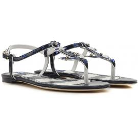 Dolce & Gabbana - Flache T-Strap-Sandalen aus blauem Lackleder