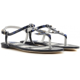 Dolce & Gabbana Flats t-Riemen Sandalen aus blauem Lackleder
