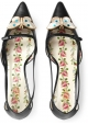 Gucci Pumps mit niedrigem Absatz aus schwarzem Leder mit Schmetterling