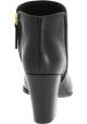 Giuseppe Zanotti Kitten Heels Stiefeletten aus schwarzem leder mit goldfarbenen Details